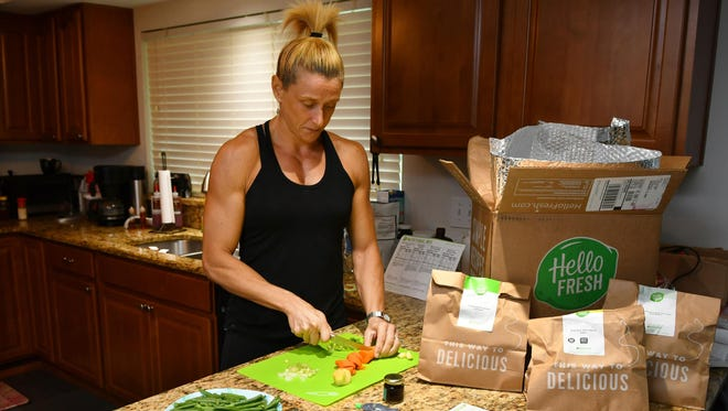 Gayle Kluesner of Indialantic orders meals for her husband and herself using Hello Fresh, which is delivered in boxes with ice packs with all of the ingredients needed.