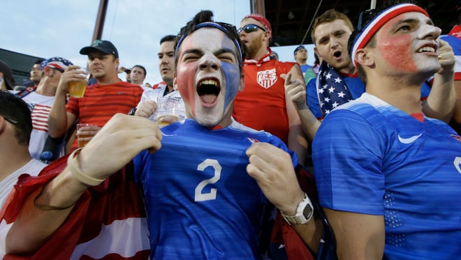 U.S. soccer fans cheer during the first half of a CONCACAF Gold Cup soccer match between Honduras and the United States in Frisco, Texas, Tuesday, July 7, 2015.