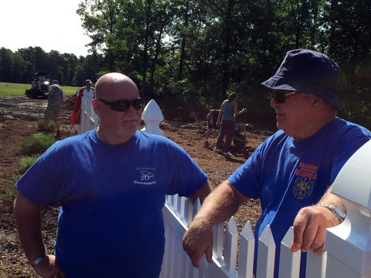 Bill Valentine speaks with a Bob Brower, a volunteer with the Where Angels Play foundation, volunteer at the entrance to the Jackson Garden of Hope, a place for parents to grieve the death of their children which he founded after his own daughter's death.