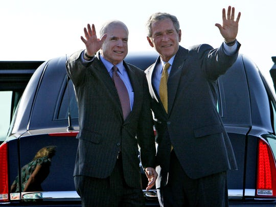 President George W. Bush and Republican presidential candidate Sen. John McCain, R-Ariz., wave at Phoenix Sky Harbor International Airport  in Phoenix on  May 27, 2008.