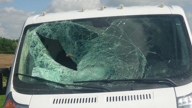 The shattered windshield from the crash on Interstate 90 caused by a turkey.