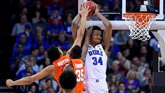 Duke's Wendell Carter holds the ball against the Syracuse defense during the semifinal of the Midwest region.of the 2018 NCAA tournament at CenturyLink Center.