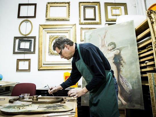 Co-owner Carl Schafer repairs a frame at Gordy Fine Art and Framing Co.
