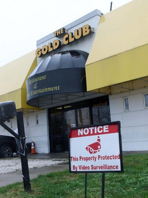 The state Department of Justice filed a complaint Thursday to close the Gold Club, calling it a criminal nuisance property that has called police to its location nearly 240 times in the past four years.