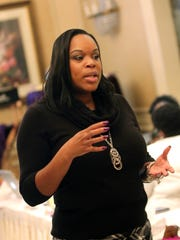 Darnyelle Jervey, of Newark,  speaks to group of women in business at an Incredible One Enterprises Event at the Christiana Hilton on Jan. 6. Jervey left MBNA to start her own business advising others on how to start their own biz.