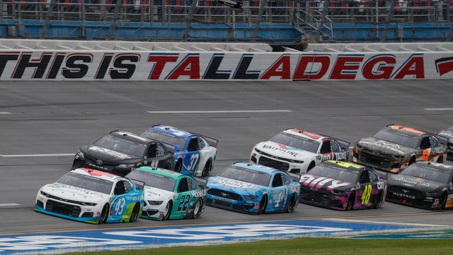Bubba Wallace (43) leads the pack Monday during a NASCAR Cup Series race at Talladega Superspeedway.