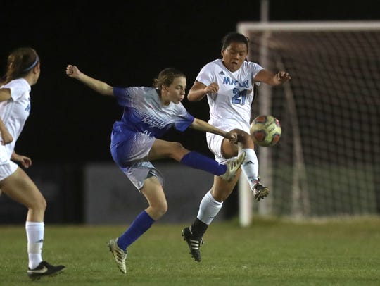 Maclay's Tayley Cotton battles for the ball against