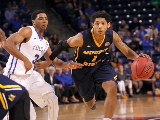 Murray State's Cameron Payne drives around Tulsa's Shaquille Harrison during the second half of an NCAA college basketball game in the National Invitation Tournament, Monday, March 23, 2015, in Tulsa, Okla. Murray State beat Tulsa 83-62.