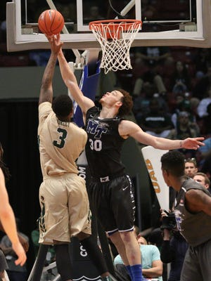 UAB Blazers forward Chris Cokley (3) has his shot blocked by Reggie Upshaw Jr. (30) during the 2015 Conference USA Tournament Championship. The Blue Raiders will need Upshaw to contribute heavily on both ends of the floor on Sunday.