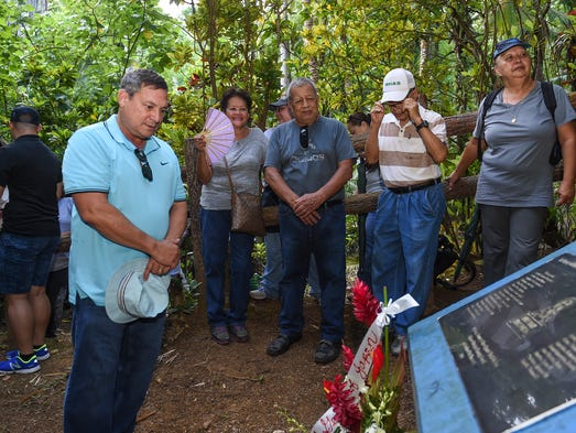 Gov. Eddie Baza Calvo pays his respects at the Tinta