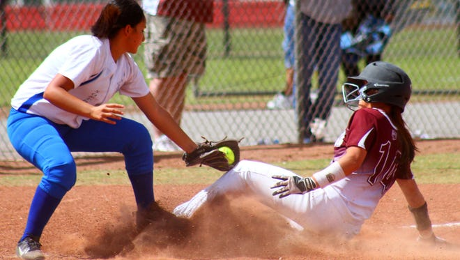 Tularosa's Jordan Gaston slides into third base safely Friday afternoon during a pool play game against Socorro at Ralph Magg Park.