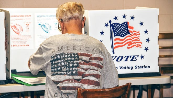 In this 2016 file photo, an Otero County resident votes at the Otero County Fairgrounds, 401 Fairgrounds Road.