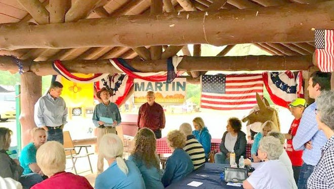 U.S. Sen. Martin Heinrich, standing at left, stopped in Ruidoso to rally Democrats and discuss problems facing the country and the state.