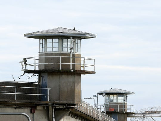 Tall concrete walls with guard towers surround the maximum-security Oregon State Penitentiary in Salem.