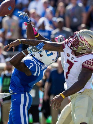 Florida State's Ermon Lane (7) breaks up a pass intended for Duke's T.J. Rahming (3) during the final seconds of an NCAA college football game in Durham, N.C., Saturday, Oct. 14, 2017. Florida State beat Duke 17-10.