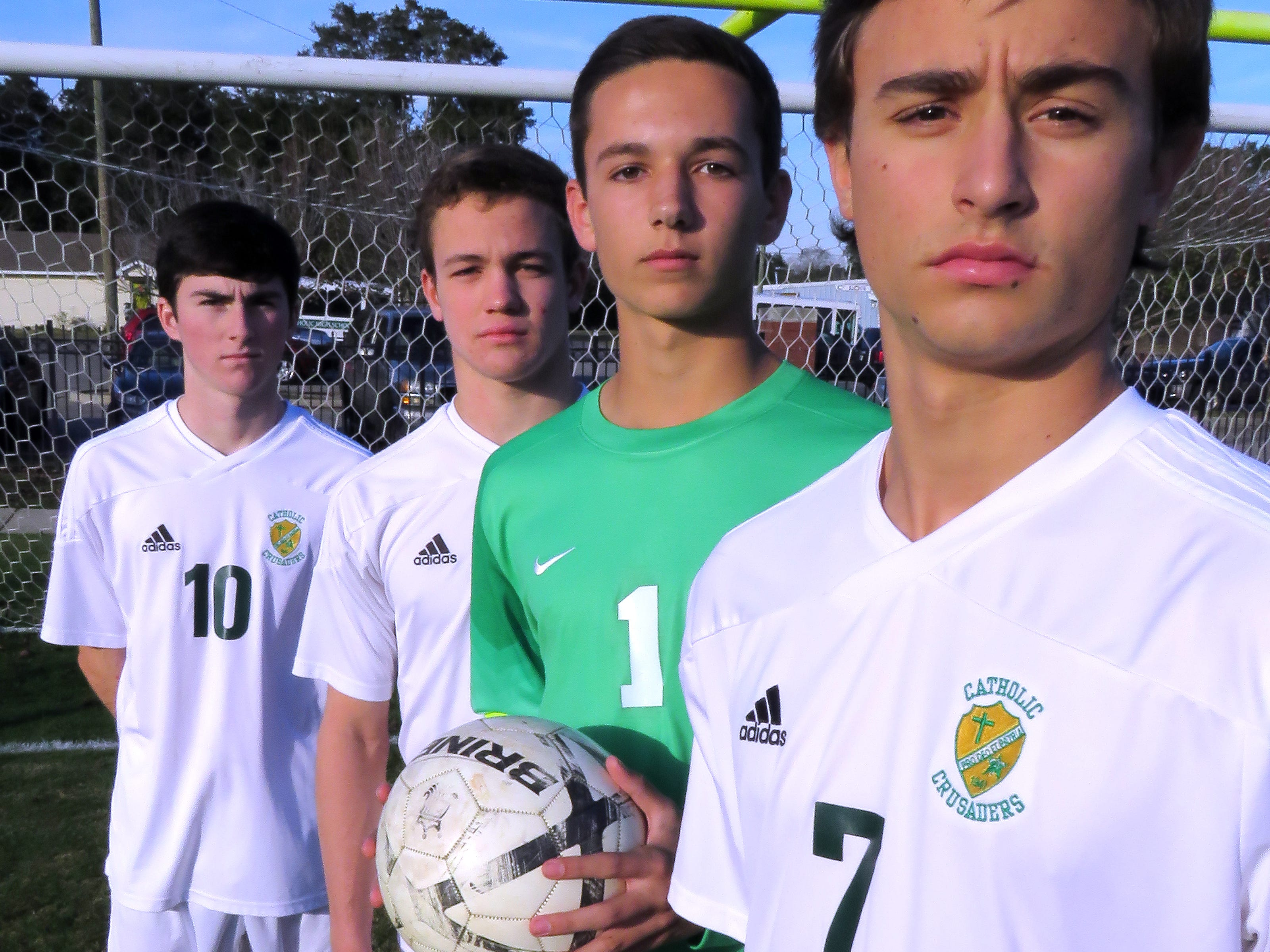 Pensacola Catholic Boys Soccer players (front to back) Seth Straw, Tanner Kukes, Erick Buer and Billy Harris.