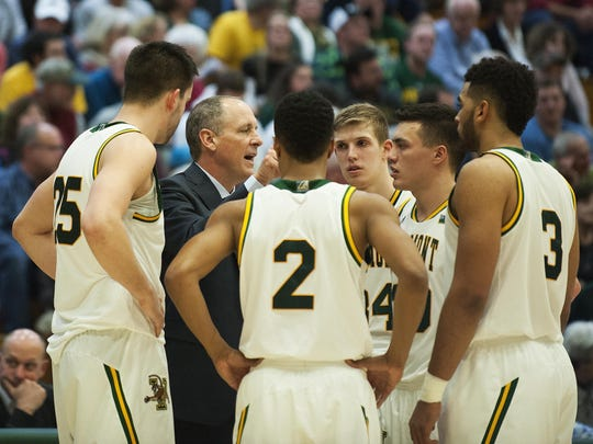Vermont head coach John Becker talks to the team during a timeout during the men's basketball game between the Harvard Crimson and the Vermont Catamounts at Patrick Gym on Monday night.