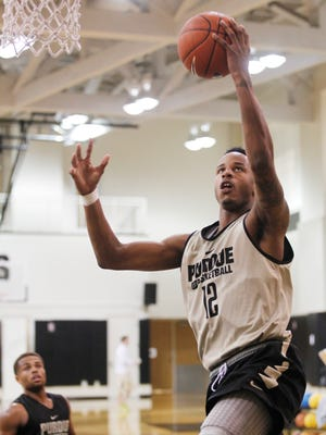 Vince Edwards with a layup during men's basketball practice Monday, October 5, 2015, at Cardinal Court on the campus of Purdue University.