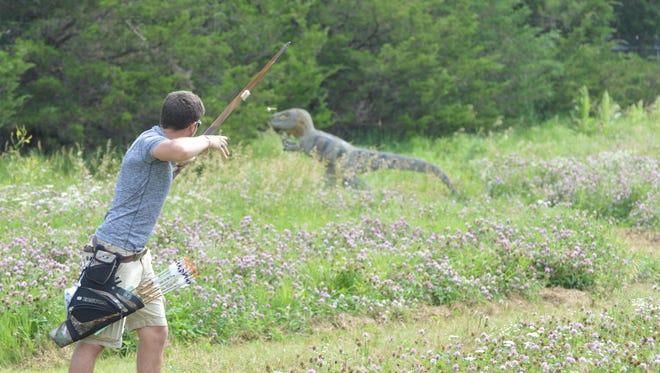 Sean Craig Jr. follows his arrow's flight after a shot at a 3D dinosaur target during the recent 4-H Shooting Sports National Championships.