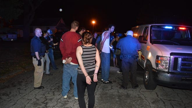 Officers arrested 11 people Thursday night after a parole visit to a home on Reller Street in Richmond.