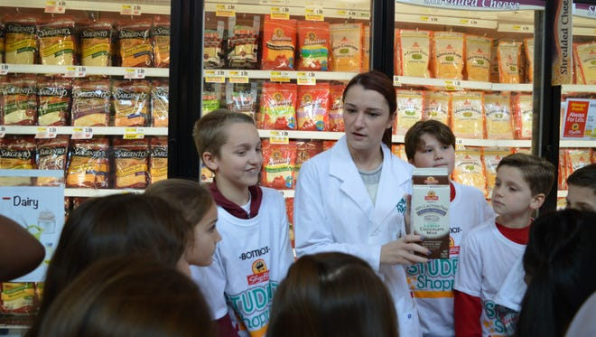 (From left) Ava Pino, Zander Rudd, Bottino ShopRite dietitian Jenna Gavigan, Robert Miskelly, Hunter Brown and other members of Megan Maher's fourth grade class from Edgarton Christian Academy discuss making healthy choices in the dairy department during a visit to ShopRite on West Landis Avenue in Vineland.
