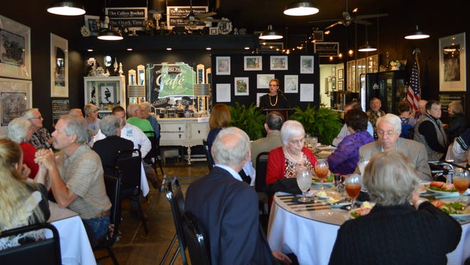 Calico Rock Museum Executive Director Gloria Sanders presents awards to donors and volunteers at the Honors Luncheon on April 19.