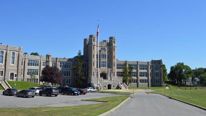 Isaac E. Young Middle School in New Rochelle is the source for a sewage leak into nearby Titus Mill Pond.