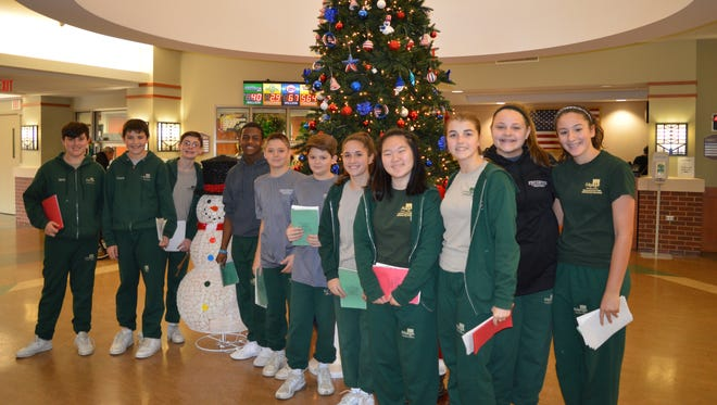 (From left) Jacob Mallon, Connor Triantos, Matthew Mallon, Noah Davis-Logan, Nicholas Volpe, Jake Caselli, Samantha Hurban, Stephanie Savela, Madeline Kavanagh, Emily D'Ottavio and Olivia Fiocchi, honor students at Edgarton Christian Academy, visited the New Jersey Veterans Memorial Home to deliver handmade Christmas cards and sing Christmas carols for the residents.