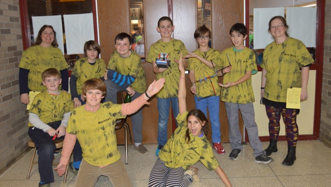 Members of the Deez Beez robotics team from Dutchess Day School pose with coaches Darlene Yager, left, and  Amanda Ruhe, right, and their robot. Students pictured standing, left to right, are Braeden McCabe, Brandon Cooke, Jake Rohan, Toby Morrow and James Patterson. Front, left to right, are JD Whiting, Marshall Page and Juliette Cooke.