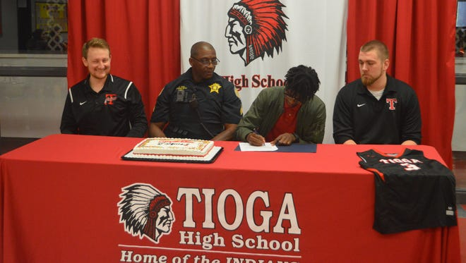 Tioga senior Jacques Clark signs with Highland Community College on April 24.