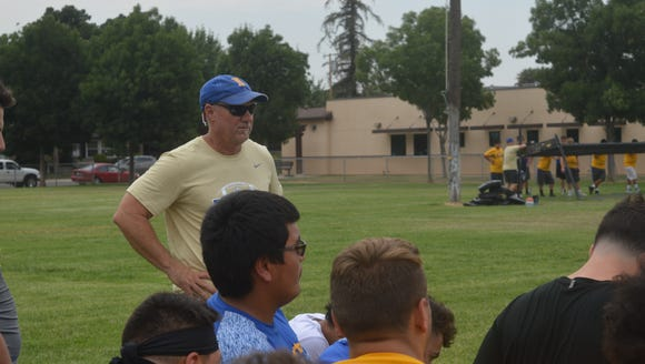 New Exeter football coach Keirsten Lamb observes practice
