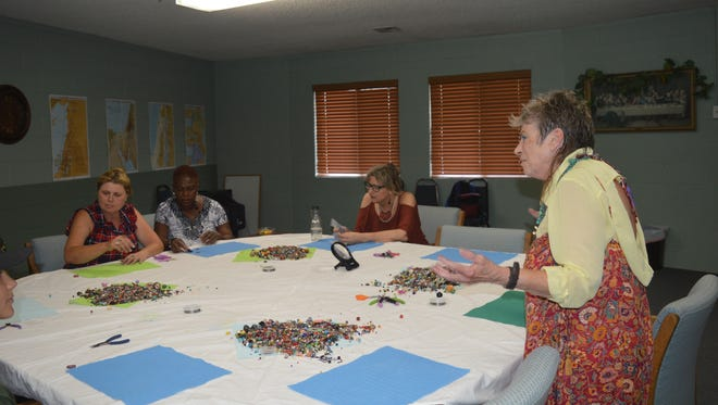 Micki Gilheany leads a jewelry making workshop in Tulare,