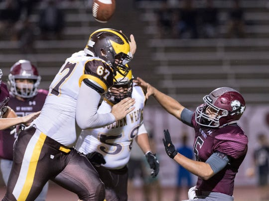 Golden West's Zac Foley pressures Mt. Whitney quarterback