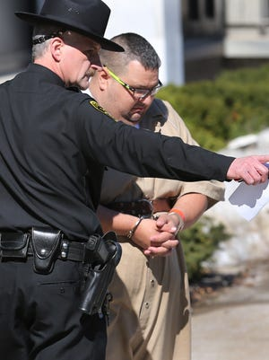 Jason Cortese is taken to back to jail after his federal court appearance Thursday.