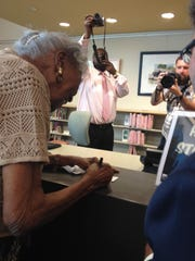 Pearl Thompson gets a library card in Raleigh, North Carolina, 73 years after being denied a card because she was black.