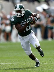 Michigan State's Aaron Burbridge makes a catch against Air Force during first half action on Saturday, September 19, 2015 at Spartan Stadium in East Lansing Michigan.