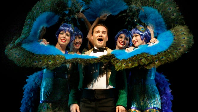 """from left, Lauren Raleigh, Jill Demchak, Jake Hanson, Elizabeth Marcantonio and Korey Beth Dixon in the peacock-inspired """"I Only Have Eyes For You"""" showgirl number in """"42nd Street"""" at the Sudgen Community Theatre in Naples, Fla., on Monday June 27, 2011. MICHELE ANNELOUISE COHEN 