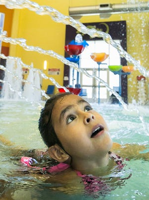 """Jornada Elementary School student Kaelie Herrera, 5, of Las Cruces, enjoys her spring break at the Las Cruces Regional Aquatic Center on Monday March, 14, 2016. """"I miss school a little bit,"""" said Herrera. """"I miss """"Daily Five"""" and free time!"""""""