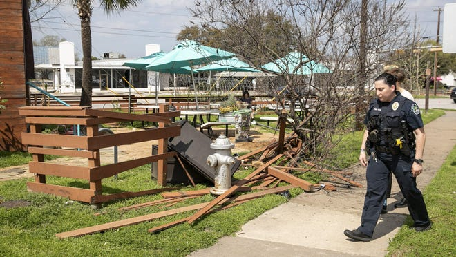 Austin police officer Laurie Gomez investigates the scene at The Soup Peddler, where seven people were injured when a car crashed into an outdoor seating area on March 11 near South Lamar Boulevard and Menchaca Road.