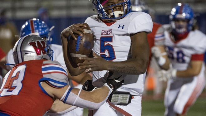 Hays' Durand Hill went 12 of 19 through the air for 178 yards and three touchdowns and ran for 106 yards and a score on just 12 carries to lead Hays to its crucial 41-35 win over Austin High.