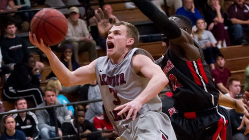 Pisgah graduate RJ McClure is a senior guard for the Lenoir-Rhyne men's basketball team.