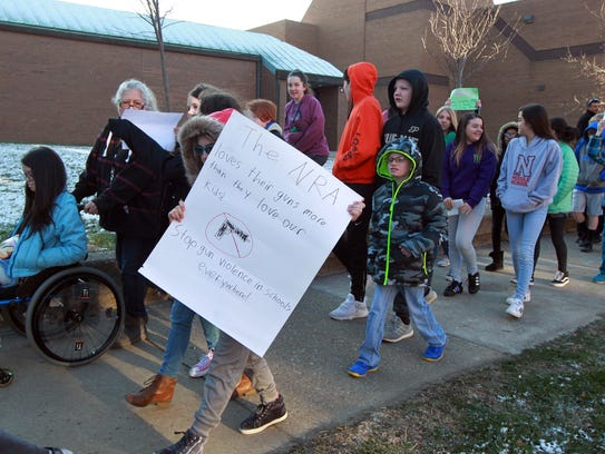Students from Noe Middle School march around their