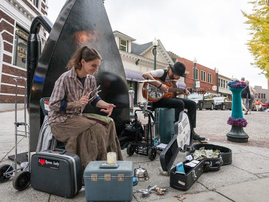 "Abby ""The Spoon Lady"" Roach and her musical partner, Chris Rodriguez, perform at the Flat Iron at Wall Street and Battery Park Avenue in Asheville."