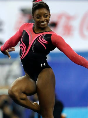 Simone Biles of the United States won four gold medals, including floor exercise on Sunday, at the world gymnastics championships.
