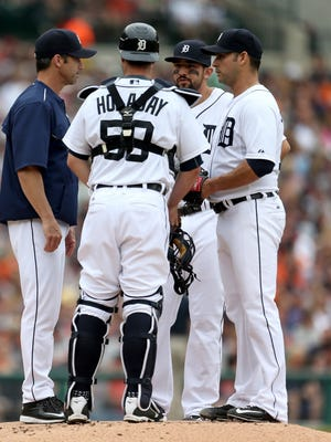 Detroit Tigers manager Brad Ausmus talks with Anibal Sanchez during the first inning against the Houston Astros  on Sunday, May 24, 2015 at Comerica Park in Detroit.