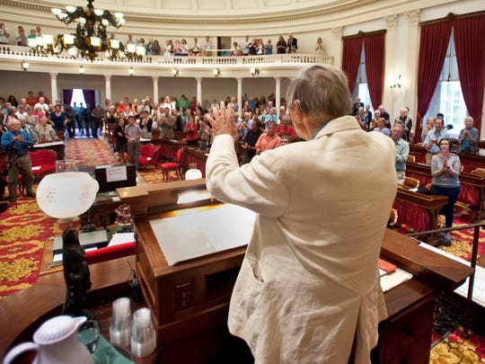 Poet Galway Kinnell acknowledges the applause from the crowd at the end of a celebration of his life and work at the Statehouse in Montpelier on Aug. 7.