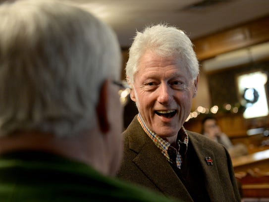Former president Bill Clinton greets diners at the