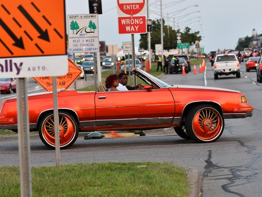How about those wheels? A colorful car makes the turnaround during the Woodward Dream Cruise on Woodward Avenue in Royal Oak, Mich. on Aug. 19, 2017. 