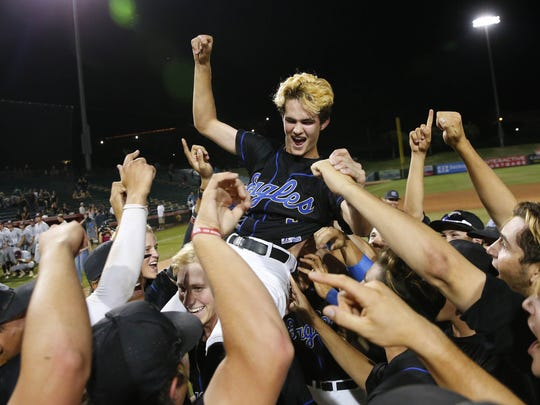O'Connor's Barrett Skaugrud (5) is carried by teammates after winning the 6A state baseball championship game against Mountain Ridge at Tempe Diablo Stadium May 15, 2018. O'Connor's Skaugrud pitched a complete game winning 7-1.