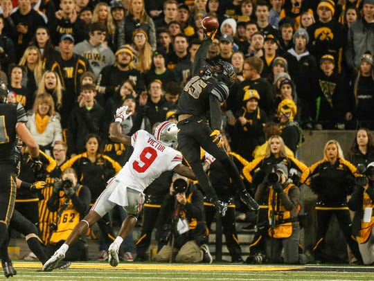 Iowa cornerback Josh Jackson intercepts an Ohio State